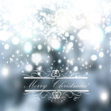 Christmas blurred background with hand drawn snowflakes and ligh Stock Photos