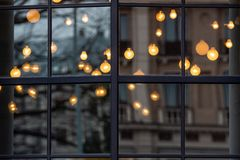Free Christmas Blurred Decorative Holiday Lights Through The Window With City Street Reflection In Glass And Bokeh Effect In Background Stock Images - 163535664
