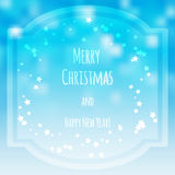 Christmas blurred greeting card with bokeh on background Stock Images