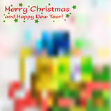 Christmas blurred greeting card with present box on background Royalty Free Stock Image