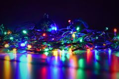 Christmas blurred lights on black background with copy space. Abstract colorful reflections of bulbs on a Christmas tree. Stock Images