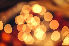 Christmas bokeh background. Christmas bokeh light abstract holiday background, yellow red and black colours Stock Photos