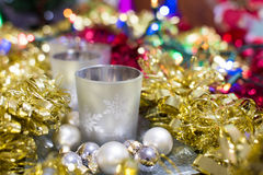 Christmas bokeh background of silver candleholder and balls. With golden and red tinsels stock photo
