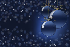 Christmas bokeh background with three christmas glass balls Stock Photos