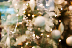 Christmas bokeh background. Christmas tree with toys Royalty Free Stock Image