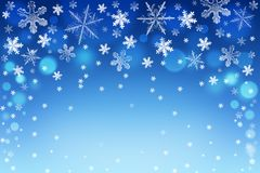 Christmas bokeh background with white and silver snowflakes Stock Photography
