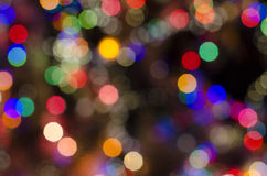 Multi-colored christmas dots in bokeh. A blurred image of Christmas royalty free stock image