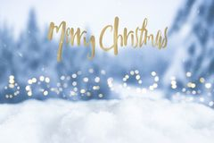 Christmas bokeh greeting card with merry christmas greeting words. Snowy christmas bokeh greeting card with merry christmas greeting words Royalty Free Stock Images