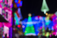 Christmas bokeh holiday background. Christmas City with Christmas lights and trees, with bokeh background Stock Photos