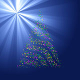 Christmas Bokeh Tree on light ray background Royalty Free Stock Image