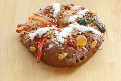 Christmas Bolo Rei or King Cake Over a Wood Table Royalty Free Stock Photo