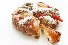 Christmas Bolo Rei or King Cake Over a Wood Table. Bolo Rei is a traditional portuguese Christmas cake made with candid fruit Stock Image
