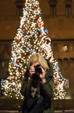 Christmas Bologna, tourist photographing the main square Royalty Free Stock Photo