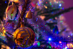 Christmas bomb. Yellow christmas bomb on the christmas tree Stock Photo