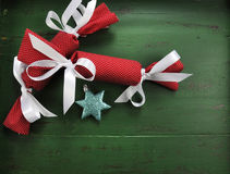 Christmas bon bons on vintage green wood background. Stock Photos