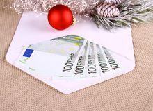 Christmas bonus as five hundred euro in envelope and decor Stock Images