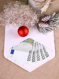 Christmas bonus as five hundred euro in envelope and decor Stock Photo