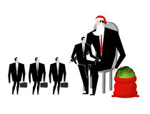 Christmas bonus. Boss Santa Claus congratulates workers. Red bag. With money. Christmas in office. New Year at work. Good Director and Managers Royalty Free Stock Photography