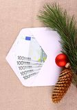 Christmas bonus, five hundred euro in envelope and decor Stock Images