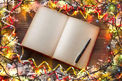 Christmas book. Christmas garlands book top view Royalty Free Stock Photo