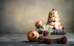 Christmas book. Christmas ornaments and an old book on a wooden table Stock Photos