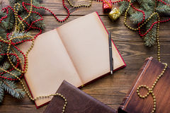 Christmas book on the table. Among the branches of trees Stock Image