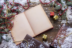 Christmas book top view. Book on a table near the trees Stock Image