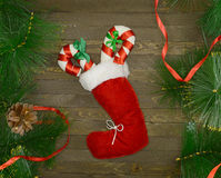 Christmas boot with candy sticks Royalty Free Stock Image