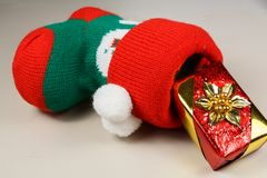 Christmas boot and gift. Red and green Christmas boot with a gift Stock Photography