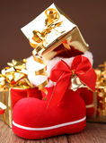 Christmas boot with presents Royalty Free Stock Photos