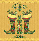 Christmas Boots with gifts  in Zen-doodle style on grunge beige background Stock Image