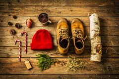 Christmas - boots, hat, hot drink, candy canes and firewood Stock Photography