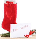 Christmas boots with a letter to Santa. Royalty Free Stock Photos