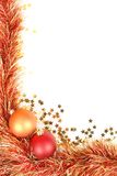 Christmas border. With red and gold Christmas decorations, tinsel and confetti and lots of space for text Royalty Free Stock Images