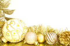 Christmas border. Golden Christmas border of baubles and shiny garland Stock Images