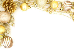 Christmas border. Golden Christmas border of baubles and shiny branches stock images