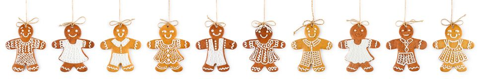Christmas Border And Ornament From Gingerbreads Boys And Girls On Ropes - Sweet Cookies Stock Photos