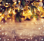 Christmas border art design with baubles and light garland Stock Photos