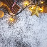 Christmas border background with cinnamon, lights of garland, and stars Royaltyfri Foto