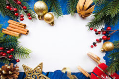 Christmas border with balls, stars and decoration on blue wooden background. Studio shot Royalty Free Stock Images