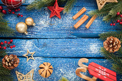 Christmas border with balls, stars and decoration on blue wooden background. Studio shot Stock Photos