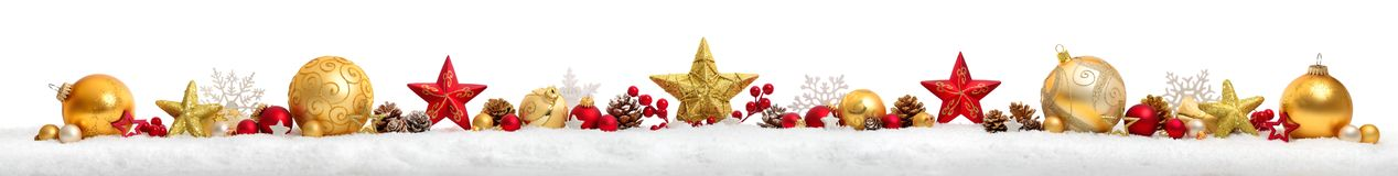 Christmas border or banner with stars and baubles, white backgro. Christmas border or banner with stars and baubles arranged in a row on snow, extra wide and stock photos