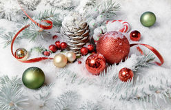 Christmas border with baubles and berries on snow Stock Photo