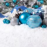 Christmas border with baubles, decorations and gifts on the snow royalty free stock photo