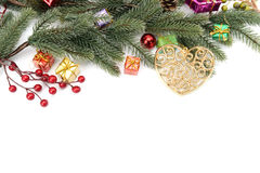 Christmas border of baubles, garland and candy. Canes Stock Image