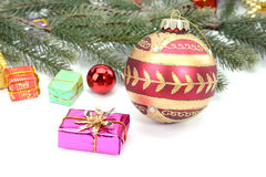 Christmas border of baubles, garland and candy. Canes Royalty Free Stock Images