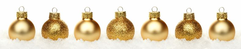 Christmas border of baubles in snow isolated Stock Image