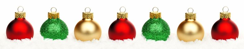 Christmas border baubles in snow isolated Royalty Free Stock Images