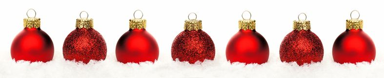 Christmas border of baubles in snow isolated Stock Photo