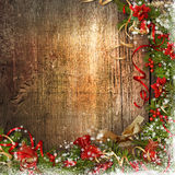 Christmas border with bell, holly, poinsettia on wood Royalty Free Stock Images